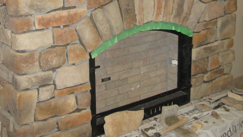 stone veneer on fireplace interior wall
